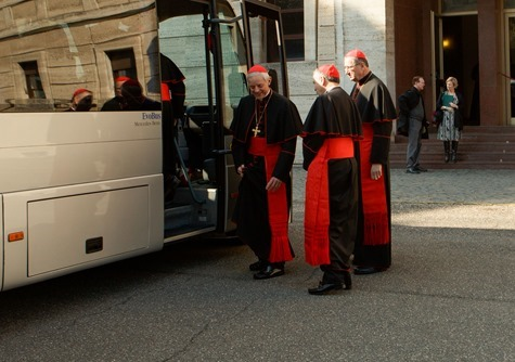Cardinals Donald Wuerl, Daniel DiNardo and Roger Mahony board a bus at Pontifical North American College in Rome on their way to a final meeting with Pope Benedict XVI February 28, 2013.