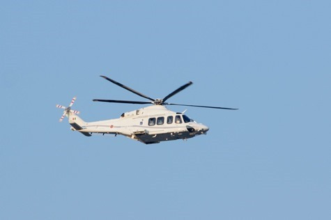 The helicopter carrying Pope Benedict XVI passes over The Pontifical North American College in Rome Feb. 28.  Pilot photo/Gregory L.  Tracy