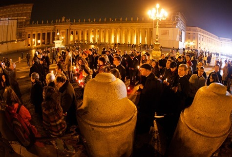 People gather in St. Peter's Square at 8 PM Feb. 28, the time when the Sede Vacante began.  Pilot photo/Gregory L.  Tracy